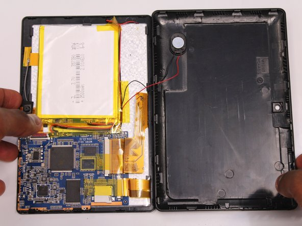 Gently remove the back case of the device and lay it in a flat surface as shown in the photo.