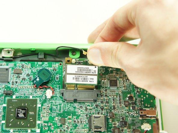 Image 1/1: Remove the wireless card by gently lifting it out of the socket.