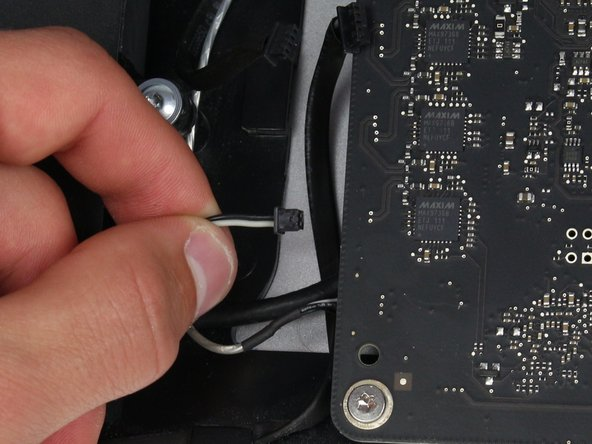 Carefully pull on the connector to release the wires from the socket in the logic board.
