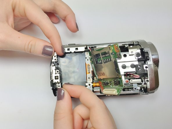 Image 1/2: Ensure that the Battery Eject button is lined up properly.