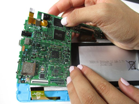 Remove the motherboard by lifting it out of the casing. Set it upside down below the casing.