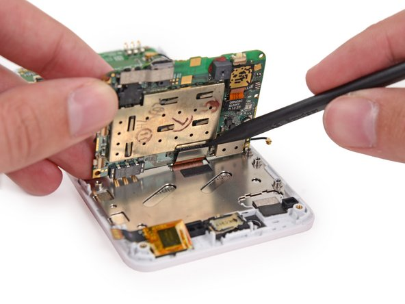 Use the tip of a spudger to disconnect the display data cable from the back of the motherboard.