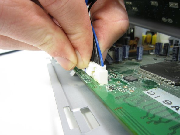 Remove the connector by pressing the upper part of it and carefully pulling it.