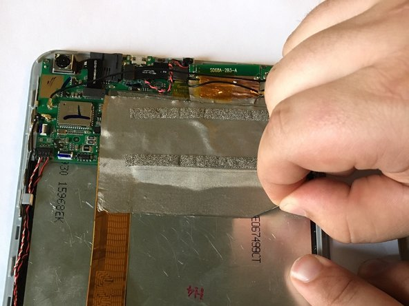 Image 1/2: Using plastic opening tools, carefully pry the connector from the motherboard.