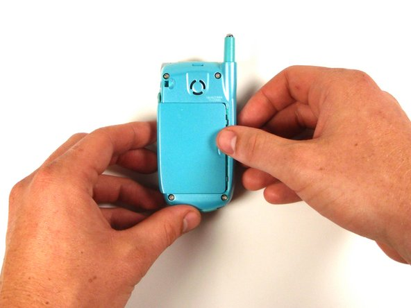 Use your thumb to push the battery cover to the left.