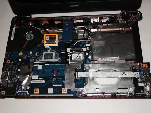 Lay the laptop base down with the screen still open.