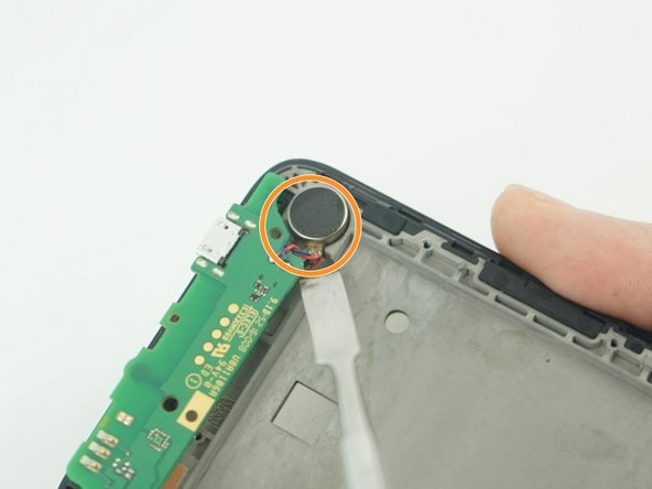 Use a metal Spudger to gentle remove the speaker that glued at the bottom left of the phone.