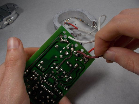 Image 2/2: The wire and all following wires will be hot, so use pliers to safely handle them.