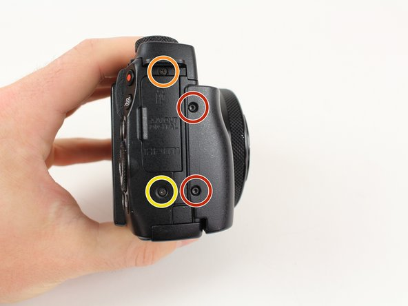 Remove the two  4mm Hex screws that connect the grip to the camera with a Hex head screwdriver.