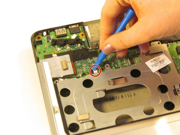 Disconnect the wire from the optical drive using the plastic opening tool.