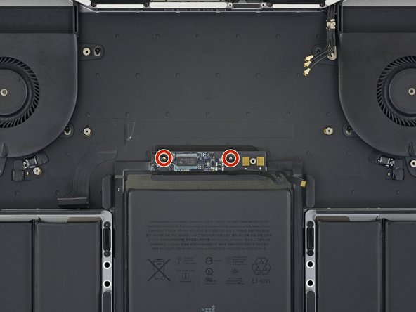 Use a T5 Torx driver to remove the two 3.2 mm screws from the battery board.
