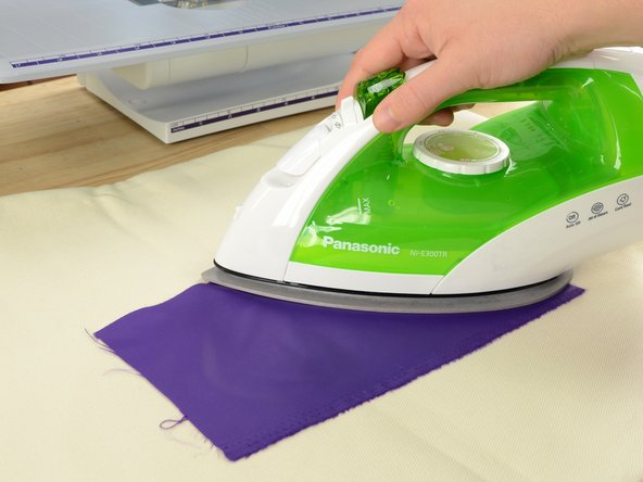 Set your iron to the appropriate setting—in our case, nylon—and iron your patch fabric to smooth out any wrinkles.