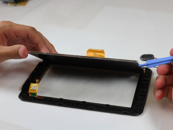 As the LCD is pried off of the front panel, some of the plastic hooks holding it to the front panel might catch on the edges of the LCD. Avoid this by gently bending the front panel outwards while removing the LCD.