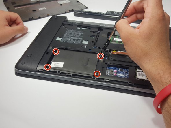 Using a Phillips #0 Screwdriver, remove the four Phillips 3 mm screws that secure the hard drive into the computer.