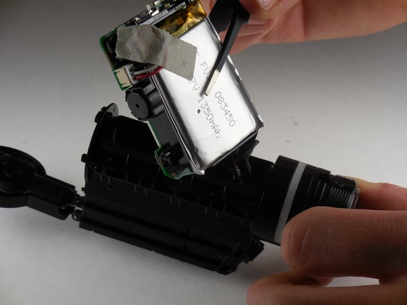 Using flathead tweezers, remove the logic board and the battery from the camera.