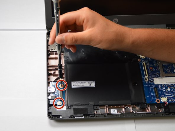 Image 2/3: Pull out the USB board from the laptop starting at its top right corner.