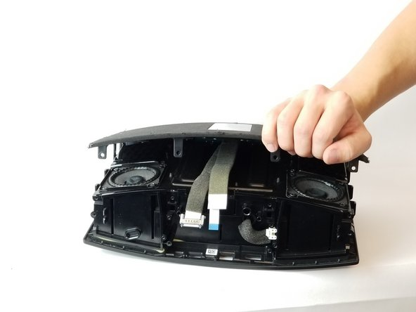 After all screws are removed, gently remove the cover from the speaker as shown in picture 3.