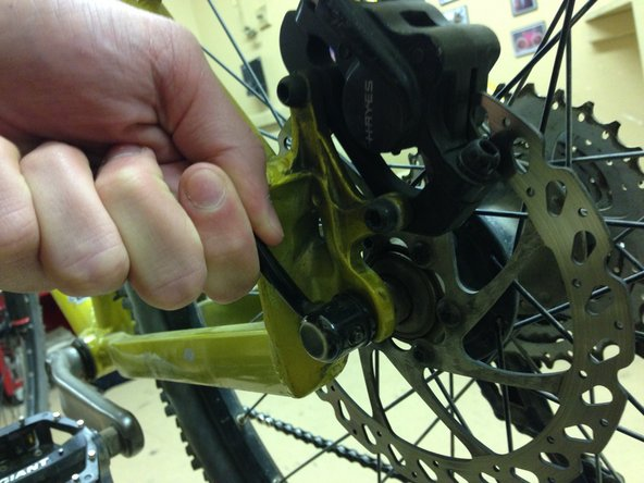 Turn the bike upside down if you don't have a bike stand. This will make it easier to remove the tire.