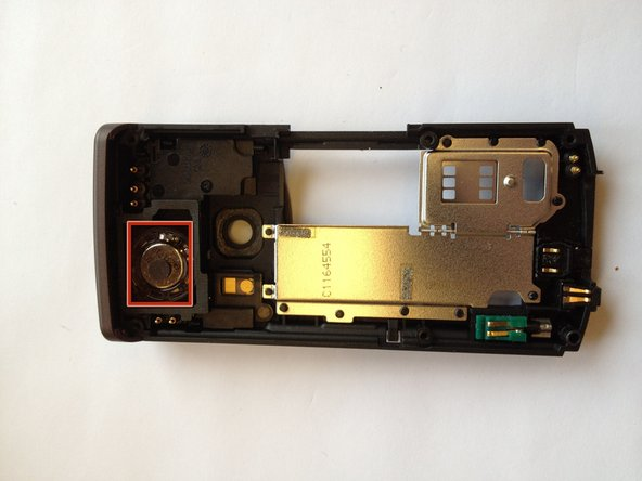 Locate the speaker location located on the back panel of the phone.