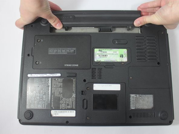 Slide the battery towards the back of the laptop until it comes free.