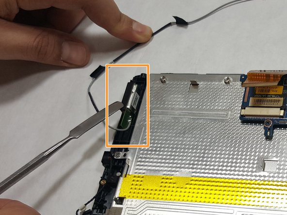 Image 3/3: With the 3G Antenna cable disconnected from the device, lift the 3G Antenna module out and remove it from the device.