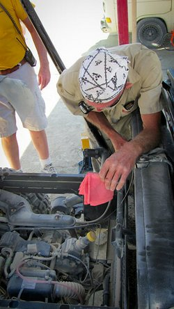Car repair while driving in the Black Rock Desert