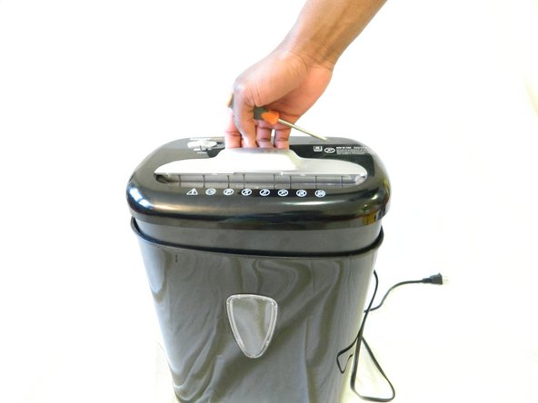 Remove the shredder assembly from the paper scrap bin.