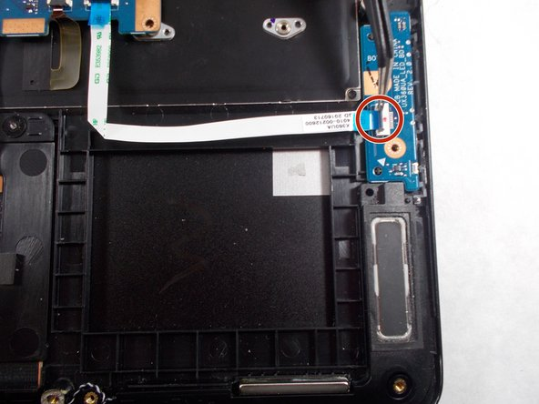 Simply lift up the black component and the ribbon connector should be released, then the power chip should pop out easily.