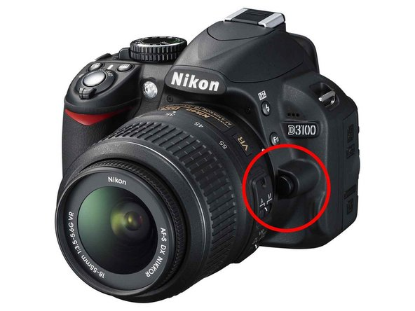 Remove the lens by pressing the release button and twist the lens.
