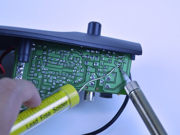Use the soldering iron to flow solder between each wire and its solder pad.
