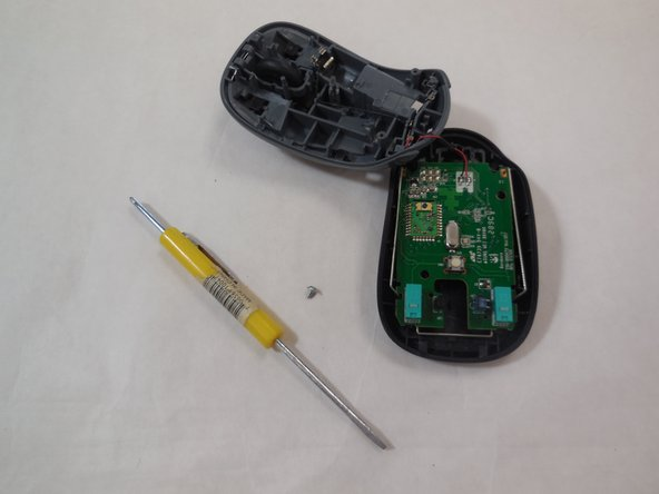 Using a phillps head screwdriver (head J000 in the ifixit toolkit), unscrew the circuit board from the mouse frame.