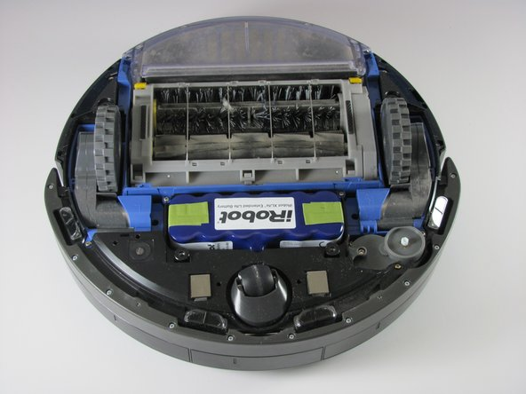 Turn the Roomba upside down, so that the vacuum and wheels are facing the ceiling.