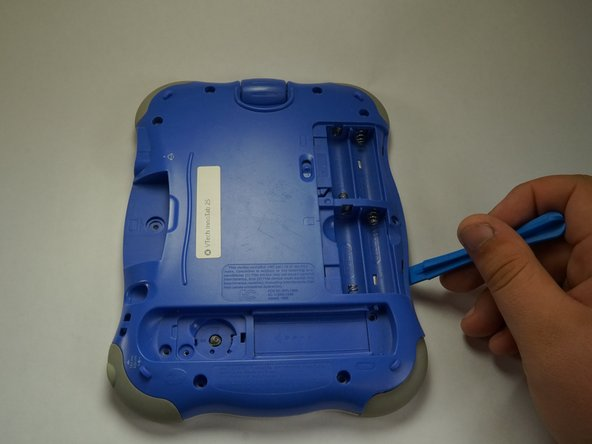 Using a plastic opening tool, detach the backplate from the front piece.