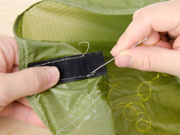 Drive the needle down through the top and bottom layers of fabric, close to where the needle came up.