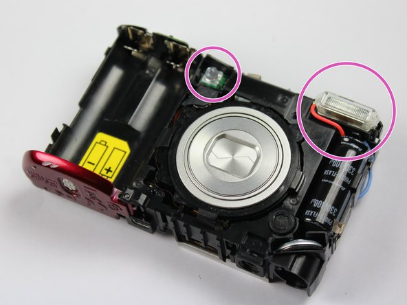 With slight force, pull the internal camera upwards and out of the front case.