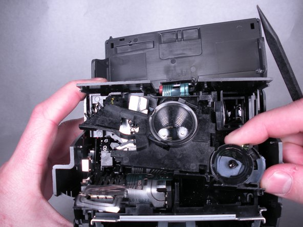 Remove the lens plate by pulling down, then away from the camera.