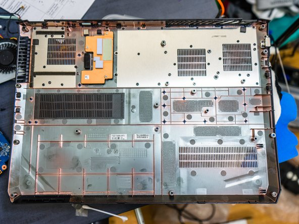 Image 1/1: Copper heatsink with heat pads for the CPU and GPU voltage regulator MOSFET/inductors. During reassembly, make sure no wires cover the MOSFETs