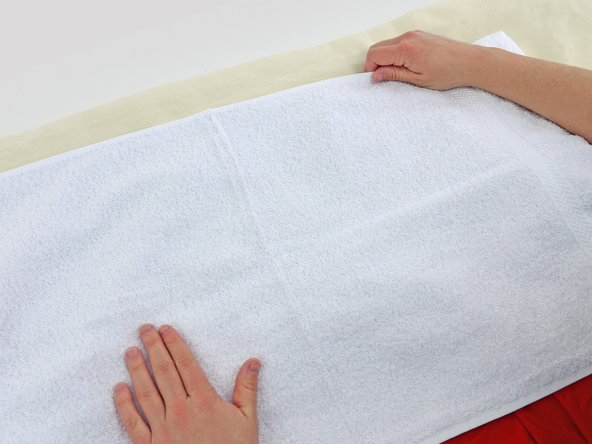 Smooth the towel out with your hands.