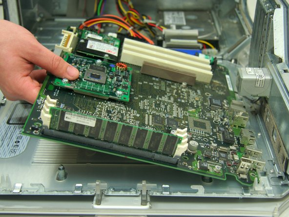 Image 2/2: Remove the barrell nut screws from the Mother Board which held the CPU board.
