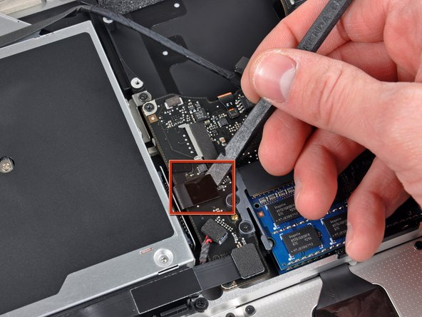 Use the flat end of a spudger to pry the optical drive cable connector up off the logic board.