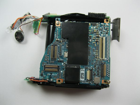 Once the lens assembly has been removed, the mother board cannot be disassembled any further.