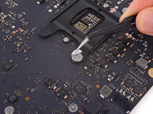 Peel off the four black tamper-evident stickers covering the heat sink mounting screws.