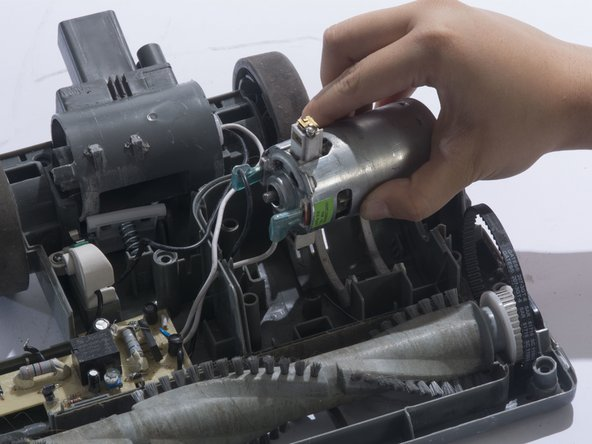 Remove the white metal wire connector from the motor.