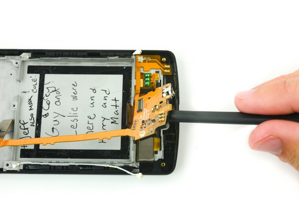 Image 2/3: Do not disconnect the daughterboard entirely. Gently fold it to the side of the phone.