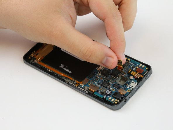 Pull the camera gently out of its housing in the motherboard with your fingers.