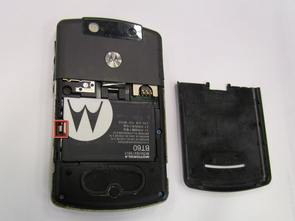 Remove the battery pack by prying it out with a fingernail, screw driver or other opening tool at the tab shown.