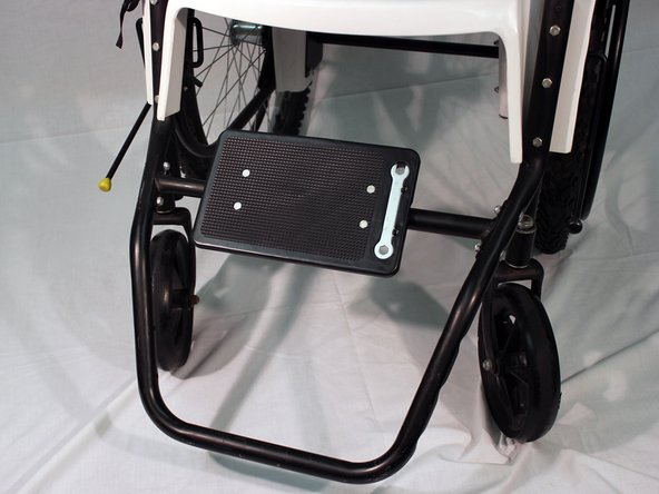 Image 1/1: The footrest may be adjusted into 4 different locations depending on the height and comfort level of the recipient