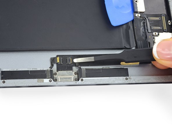 Slide the right speaker cable out of its ZIF connector.