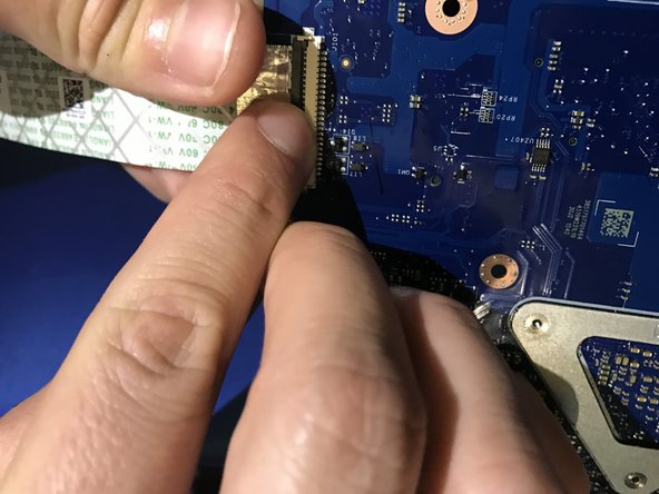 Lift the latch to disconnect the I/O-board cable from the motherboard.