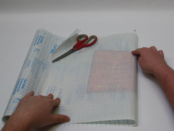 Wrap the ConTact Paper over your book, measuring out enough to completely cover the book.